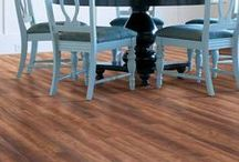 Laminate Flooring / Laminate flooring provides a low cost alternative to standard wood or stone and is resistant to staining, wearing and fading.