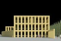 2010 - Municipio di Paratico, Brescia / La nuova sede del Municipio di Paratico, disposta secondo l'asse nordovest sudest, è caratterizzata da una galleria centrale pedonale illuminata zenitalmente da lucernari a shed rivestiti nel lato sudest da celle fotovoltaiche. L'accesso pedonale all'edificio è da via XXIV Maggio. A tale ingresso si perviene dal sistema pedonale previsto sul lato nord di via Risorgimento, parte scoperto e parte porticato, che confluisce in un sistema di piazzette.