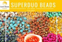 SuperDuo Czech Glass Beads: Tutorials, Patterns, Inspiration / These innovative Czech Glass SuperDuo Beads feature a unique shape and two stringing holes. They fill in gaps nicely, join up well and create floral patterns in designs. Because of their uniformity, SuperDuo Seed Beads can be used in any type of your handmade jewelry. We at CzechBeadsExclusive releasing for you Czech Glass Superduo Beads in 3 absolutely new adorable finishes: Matte Fool`s Gold finish, Stardust finish and Matte Capri Gold. Check these beads right now!
