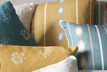 Cushions / At Kate Medlicott Studio we are able to make a variety of cushion shapes and sizes, piped or plain, with a simple mother of pearl button back fastening and a luxury duck feather inner.