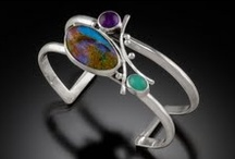 Marilyn Greenwood / Marilyn is inspired by the interplay of energies created by combinations of diamonds, opals, druzes, and other unusual gemstones, as well as the familiar, such as lapis, amethyst, and tourmaline.  Her portfolio is mostly comprised of one-of-a-kind and custom pieces, with a few more popular styles in limited editions.  Marilyn's work is all hand-fabricated using sheet, tubing, wire, and handmade balls in 14K and 18K gold and silver.