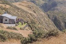 The Lodge / Perched on a cliff 750 ft above the Tasman sea, surrounded by 3000 acres of farmland. Nestled into the natural surroundings, The Lodge has a feeling of warmth created by the Jarrah flooring, huge wharf beams and roaring open fire.