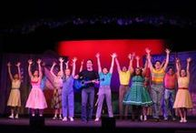 """""""All Shook Up"""" - 2014 Season - July 2 - 27, 2014 / Inspired by and featuring the songs of Elvis Presley. It's 1955, and into a square little town in a square little state rides a guitar-playing roustabout who changes everything and everyone he meets in this hip-swiveling, lip-curling musical fantasy that'll have you jumpin' out of your blue suede shoes with such classics as Heartbreak Hotel, Jailhouse Rock, and Don't Be Cruel."""