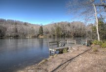 1100 Deer Park Lake Road, Spruce Pine, NC 28777.  $325,000.00 MLS#: 27922 / Beautiful lake frontage home- 4 bed, 3 bath, 3,050 sq. ft., private dock; enjoy swimming, fishing, kayaking; the home is updated & move-in ready; vaulted ceilings, new oak hardwood floors, fireplace, large kitchen, master with water view, finished walk-out basement, , large decks, 2 car garage, play ground with tree house, paved street, minutes to hospital, shopping, golfing & all area amenities.