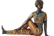 Yoga Inspired Art / A collection of figurines based on classic yoga poses, as well as other pieces to decorate your yoga or mediation area from The Guiding Tree.