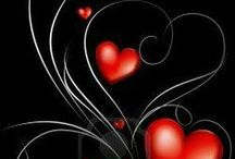 """Black & White - Pop of Red Hearts / Red hearts that say """"I Love You""""."""