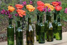 Flowers in Bottles / Groupings of flowers in bottles or tiny vases.