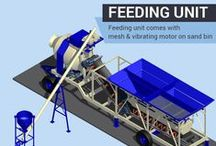 Mobile concrete plant with reversible drum mixer.
