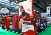 Food & Beverage Displays / Food and Beverage marketers have unique exhibit requirements, and that's where Nomadic Display excels. Our design studio creates fresh display designs to build your brand with functionality that leaves a lasting impression. Browse the high-impact trade show displays that Nomadic has produced for clients such as Twinings Tea, Krispy Kreme and Dr. Pepper. Nomadic trade show display solutions can help any business in any industry!