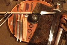 Viking Weapons / The Viking panoply consisted of a round shield with a steel boss, an axe, a spear, and -- if the individual was rich or lucky -- a sword.  Many also commonly carried various fighting knives, especially the seax.  The feared Dane Axe was a large pole arm capable of splitting shields and smashing through defensive formations.  Arms were the privilege and mark of a free man in the Viking Age.