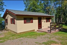 77 Sunset Strip - Lower Clam Lake / 77 Sunset Strip is a newly remodeled 2 bedroom, 1 bath four season cabin with central heat and air conditioning overlooking beautiful Lower Clam Lake and its wooded shoreline within the Chequamegon National Forest northeast of Hayward, WI. Located on Highway 77 3 miles west of Clam Lake, Wisconsin, this cozy cabin was beautifully refurbished in 2010. The open interior with knotty pine walls and ceilings is open, bright and offers a picturesque view of the lake. / by Clam Lake Property Management LLC