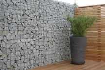 "Structure | Gabions / A gabion (the italian meaning for ""bird cage"") is a cage, cylinder, or box filled with rocks, concrete, sand or soil. Typically used for engineering and military applications, gabions are now being used in landscape design for a variety of purposes."