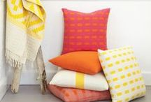 Indigenous Blooms Collection      Bolé Road Textiles / Our debut collection is inspired by springtime in Ethiopia, when the air is crisp, the weather is warm and pleasant and the country is speckled with the vivid yellows, reds and fuchsias of its indigenous blooms. Special among this bounty of flowers is the bright yellow Adey daisy. Taking a cue from this explosion of flowers, we've named each of the pillows in this collection after the flower that inspired its design.