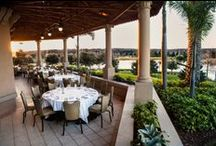 Dining Al Fresco / Please join us on our new outdoor terrace! Our terrace is fully covered, fully equipped with fans, heaters, and roll-down walls, so it is a beautiful space regardless of the weather.  Watch the sun set over our beautiful lake, gardens, and Greg Norman Signature Golf Course... could anything be more inviting?!