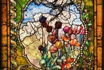 The Genius of Tiffany / Louis Comfort Tiffany (1848-1933) was an American artist and designer heavily associated with the Art Nouveau and Aesthetic design movements. Although he created work in many fields of the decorative arts, he is best known for his lustrous stained glass creations.