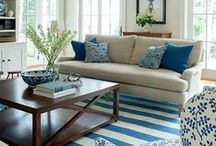 Coastal Chic Interiors / A relaxed, summery feel is created with neutral walls and flooring mixed with sandy blue-grey furniture and accessories. Beach-themed ornaments and seascape artwork complete the look.