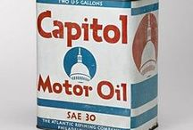 Motor oil signs and cans