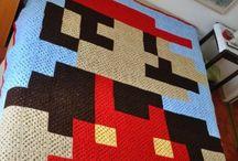 8bit blankets / Selfmade crochet 8bit pixel blankets. Some joy for every geek heart.