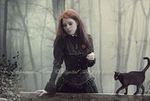 Witches Familiar / The cat as black as night prowls this board as the witches familiar.