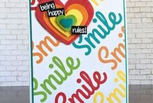 Sassy Smiles / Sassy Smiles, 4 x 6 set of 9 clear photopolymer stamps.  $15.00 www.cas-ualfridaysstamps.com   A great big smile will be easy to send by itself or paired with 1 of 5 coordinating sentiments and 3 fun shapes! Great for lots of everyday occasions. For even more fun, pair this set with our Fun-Fetti Fri-Dies, sold separately.  Made in the USA