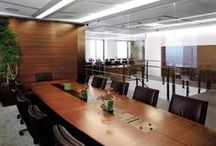 "Hedge Fund Manager Office / The space is located on three contiguous floors connected by internal stairs. The floor plans are organized around internal ""courtyard"" spaces containing trading and support services bounded by glass enclosed offices occupied by management and research personnel. The courts, punctuated by the sculptural presence of the stairs, are suffused with natural light and enlivened by views of Central Park and the Hudson River."
