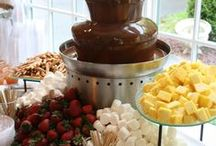 S'mores Satation & Chocolate Fountain / A S'mores station is perfect to have at your event as a late night snack for your guests. By having a station, this allows your guests to choose what type of dip they have on their treat and what toppings to add to it!  www.twofatmencatering.com