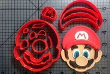 Video Game Items / Vist jbcookiecutters.com to view all of our Video Game themed items. Our items include cookie cutters, stencils, stamps, silicone molds, rolling pins, plungers and many more!