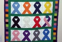 Quilts, Blankets, & Fabric Awareness Ribbon DYI Projects and Art Ideas / Featuring awareness ribbon projects that use quilting fabric and other similar items that are DYI art projects or items to buy.  Pins are potential great ideas for fundraising or awareness art gifts!