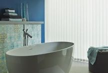 Vertical blinds / Made to measure vertical blinds offer the perfect balance of light, privacy and of course style. They can look great in a conservatory, a living room, a kitchen and even offer a practical solution to your bathroom.