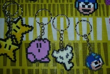 Bead Sprites (Mini) / These are some of my creations. I make bead sprites out of videogame characters and customized orders. You can find more about these accesories (Earrings, rings, necklaces, keychains, cellphone charms, little plants, etc. at www.thepixelartstore.com - we ship internationally.