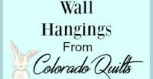 Wall Hangings from Colorado Quilts / A quilt of any size can brighten your walls. These little wonders are especially sized for for any wall space. They are available with a hanging sleeve so that you may quickly hang them with dowels or decorative curtain rods.