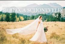 Rebecca Schoneveld / Rebecca Schoneveld creates original, locally handcrafted gowns for brides who are seeking a modernly romantic aesthetic. Rebecca is inspired by bohemian yet streamlined silhouettes, gorgeous textiles such as French lace and pure silks, and the natural beauty and personality of our brides themselves. Much of the collection is designed into components that can easily be custom mix-and-matched in hundreds of surprising and becoming ways.