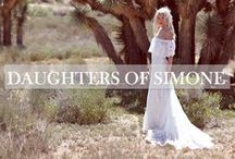 Daughters of Simone / Daughters of Simone is a bohemian non-traditional bridal gown company in New York City. Inspired by fashion muses of years gone by -  including their mothers very own 1970′s shoulder-baring wedding gown - designers Ash and Brit aim to make each gown their own. What started with just a handful of re-constructed vintage gowns has since grown into a brand that offers a curated vintage selection and three originally designed collections.