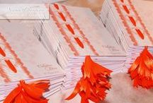 Il Matrimonio di ELISA & VALENTINO / Partecipazioni, Libretti Messa, Rotoli porta Menu e Libro degli Ospiti, coordinati. Colori dominanti bianco e arancione.