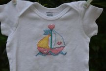 Baby Clothes / The creations of one talented Counted-Cross-Stitcher!! / by Ned Bossio