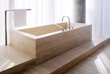 Bathroom Interiors / Bathrooms with clean lines but warm, natural materials like natural stone, marble, dark wood and a wellness atmosphere.