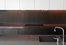 Kitchen Interiors / Kitchen interiors with clean lines and sculptural shapes. Minimal white volumes combined with warm, natural materials like natural stone, marble or wood.