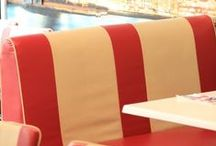 1950s American Diner / Red and cream furniture, checkerboard floors and neon lighting. The American diner theme is quirky and fun and perfect for the retro 1950s look.