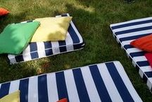 Custom Cushions & Pillows for Outdoor Summer Party / Gala Cloths had custom cushions and pillows fabricated for a favorite designer who was styling a client's very special outdoor movie birthday bash! Lots of precision matching of stripes, miles of white piping, and complementing table linens.