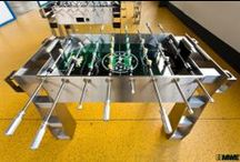 ► KICKER TABLES / Make your house or office a World Cup Stadium! This soccer table matches perfectly into every room and is a great aid against boredom not only during the half time breaks. Accurate manufactured pawns, solid game counter and many more beautiful details make this soccer table very unique.