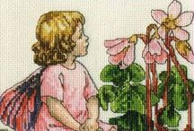flower fairies ask for stitch pattern / just ask if you search a flower fairie pattern, can check a large collection from small to big- from very old to now and lotts of designers who created them.