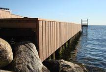 Azobé til badebro / Keflico A/S blev i foråret 2012 kontaktet af tømmerhandel Johannes Fog A/S i Hørsholm. Af forskellige årsager var de kommet i tidsmæssigt bekneb og skulle nu hurtigst muligt bruge FSC certificeret Azobé træ til deres kunde Bent Nygaard Sørensen, der var i gang med et projekt for Carlsberg Ejendomme i Hellerup – en badebro ved Tuborg Havn.