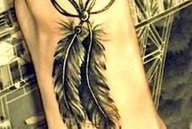 Tatuointeja ja lävistyksiä