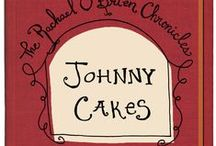 Johnny Cakes / On campus, academics would be a breeze if the most feared professor on campus hadn't trapped Rachael into interning. The professor's new extra-curricular import venture uses Rachael as free labor. When deliveries go missing, so does a roommate and an international art smuggling scheme, with life-or-death stakes is uncovered in Paisley Ray's JOHNNY CAKES. Available on Amazon.com.