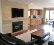 Brecksville Family Room / The homeowner wanted an updated and contemporary living room with clean lines. They wanted the fireplace wall to be a featured focal point of the room but not overwhelming.