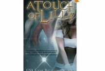 A Touch of Lilly / Ex-Chicago detective LILLY D'ANGELO has a secret she doesn't share with anyone. A master of the one night stand, she's given up ever finding a soul mate and thrown herself into her career. That is, until she captures the wrong alien and is shipped into deep space. Now Lilly has become a bounty hunter hell-bent on revenge.
