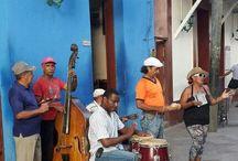 El Caribe / En este tablero tengo fotos de Cuba, La República Dominicana, Haití, Puerto Rico, Las Islas Bahamas y Jamaica. Países que se relacionan con mucha sensualidad, buena música y problemas sociales.