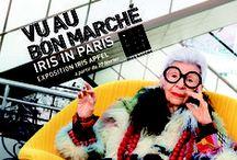 Iris In Paris / Du 27 février au 16 avril, c'est au Bon Marché Rive Gauche qu'Iris Apfel se dévoile. Photographiée et filmée chez elle, la muse de New-York livre quelques secrets de sa collection au sein d'une exposition baptisée Iris in Paris*, à retrouver dans les vitrines rue de Sèvres, et à la Galerie du rez-de-chaussée. (*Iris à paris)