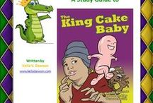 "King Cake Baby Study Guide, Activities & Song / The King Cake Baby is a lively adaptation of ""The Gingerbread Man"" set in New Orleans. The runaway baby escapes an old Creole couple before he's hidden inside a king cake. He outruns a praline lady in Jackson Square, and a waiter at Café du Monde. But can he outrun a clever baker? This retold tale brings a tasty tradition to life for readers. An easy king cake recipe is included. Bon appétite!"