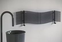 Albatros / This model features horizontal tubular elements (14 mm) made of manually bent carbon steel. On request it can be equipped with a decorative element on the central reinforcing that replicates the sinuous lines and evokes the wing span of an albatross. The radiator is available in chrome-plated finish or polyester power paint finish.